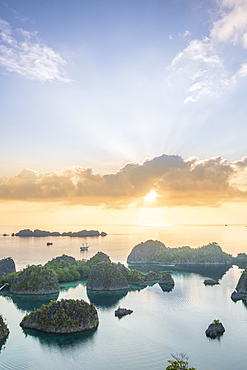 View over a bay of islands at dawn from the Piaynemo lookout, Raja Ampat, West Papua, Spice Islands, Indonesia, Southeast Asia, Asia