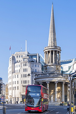 A red double-decker bus on Regent Street in front of BBC Broadcasting House and All Soul's Church, Langham Place, London, England, United Kingdom, Europe