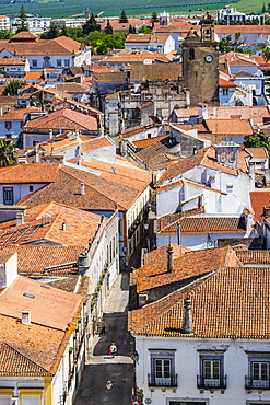 A woman walking down a deserted street in the historical centre, Beja, Alentejo, Portugal, Europe
