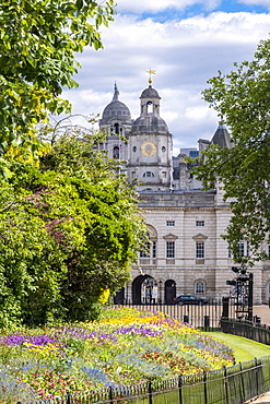 Horse Guards building from St. James's Park showing spring flowers in the flower beds, London, England, United Kingdom, Europe