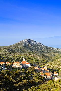 Velo Grablje village and mountains against the Adriatic Sea, Hvar Island, Dalmatia, Croatia, Europe