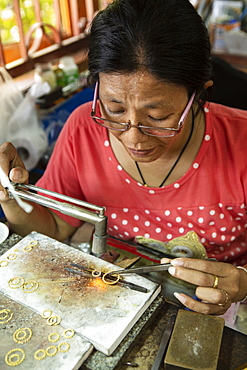 A goldsmith working in a jewellery factory, Thailand, Southeast Asia, Asia