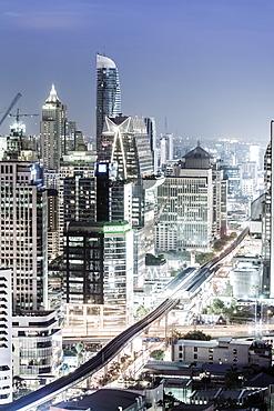 Bangkok skyline showing the Skytrain and Chit Lom, Sukhumvit and Ploen Chit areas, Bangkok, Thailand, Southeast Asia, Asia