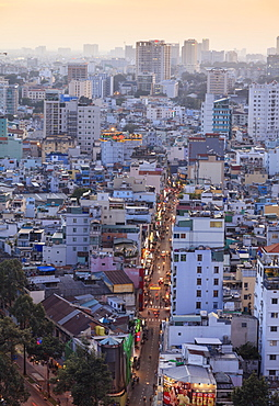 View of Bui Vien street and the skyline of downtown Ho Chi Minh City (Saigon), Vietnam, Indochina, Southeast Asia, Asia