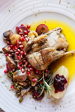 Portuguese Mediterranean dish of roast chicken in olive oil served with rosemary and pomegranate, Portugal, Europe