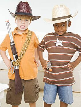 Two young boys dressed as cowboys