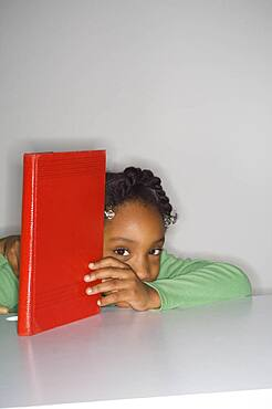 African girl holding book