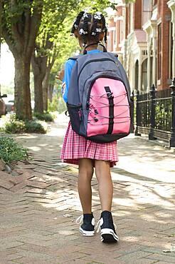 African girl wearing backpack