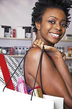 African woman carrying shopping bag