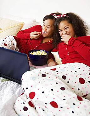African twin sisters watching movie