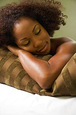 African woman laying on pillow
