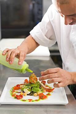 Hispanic male chef preparing food