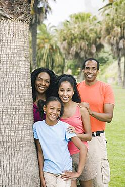 African family next to tree