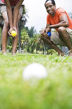 African couple playing bocci ball