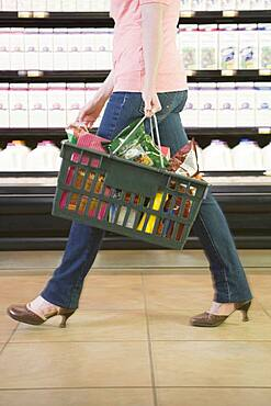 Woman carrying grocery basket
