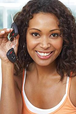 African woman holding up car keys