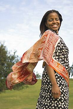 African woman wearing dress outdoors