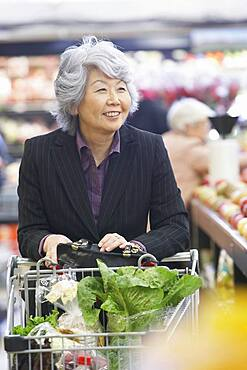 Senior Asian woman in grocery store