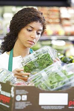 Mixed Race clerk in grocery store