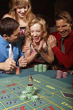 Woman successfully gambling in a casino