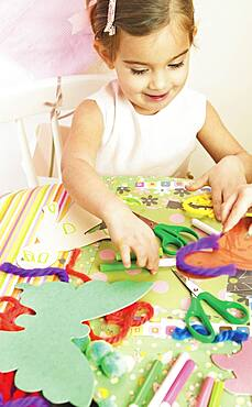 Young girl doing arts and crafts