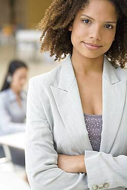 African businesswoman with arms crossed