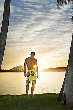 Asian man watching sunset