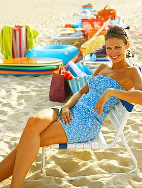 Young women sitting in beach chair