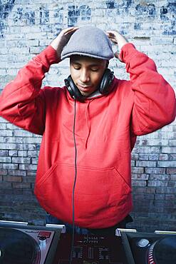 Teenage boy using turntables and headphones