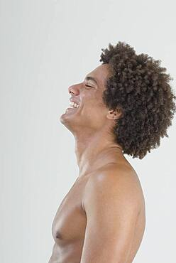 Mixed Race man with bare chest