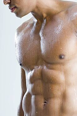 Close up of nude, wet African man