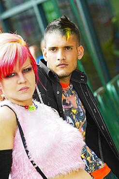 Close up of Hispanic punk couple outdoors