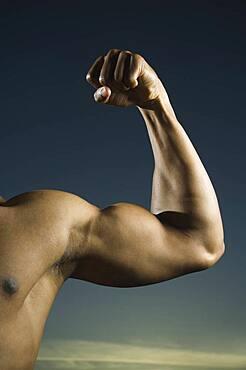 African American man flexing biceps