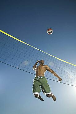 African American man playing volleyball