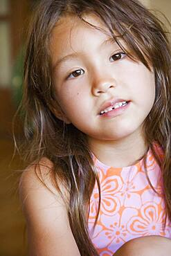 Close up of young Asian girl indoors
