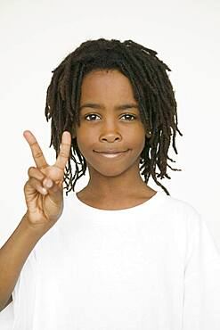 African boy making peace sign with hand