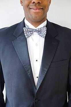 Close up of smiling groom wearing tuxedo
