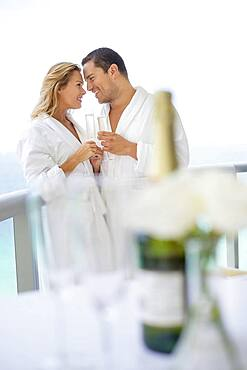 Couple drinking champagne on balcony table