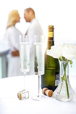 Close up of champagne glasses on balcony table