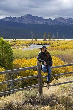 Caucasian woman under Sawtooth Range, Stanley, Idaho, United States