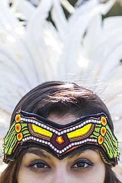 Native American woman wearing traditional headdress