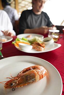 Close up of plate of shrimp on restaurant table