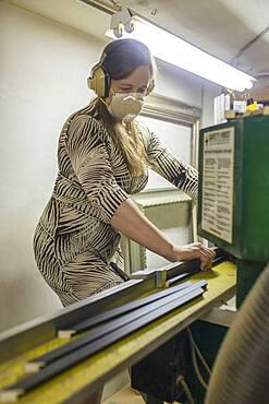 Caucasian artist working in workshop