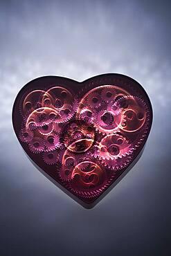Mechanical gears turning in heart shape