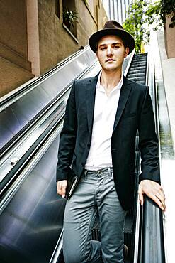 Caucasian businessman on escalator
