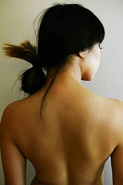 Rear view of nude Japanese woman