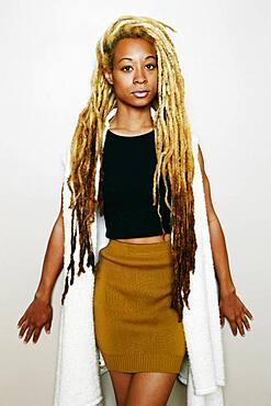 Stylish Black woman with dreadlocks