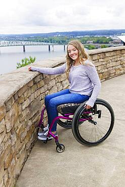 Caucasian disabled girl in wheelchair overlooking Columbus cityscape, Ohio, United States
