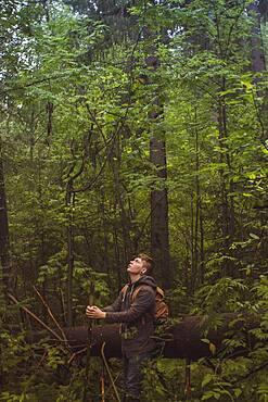 Caucasian man walking in forest