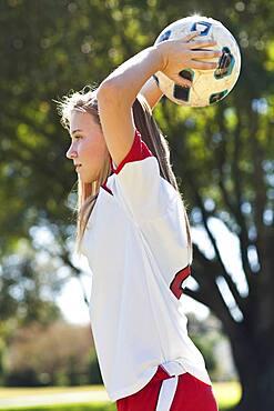 Caucasian soccer player throwing ball